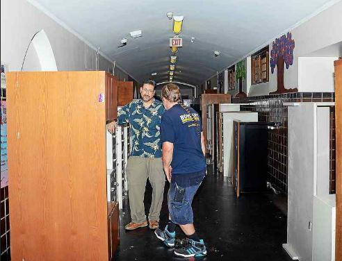 Some of the 200 pieces of furniture that Princeton University donated to Grace Dunn Middle School in Trenton fills the hallway in the public school on July 18, 2017. (GREGG SLABODA - The Trentonian)