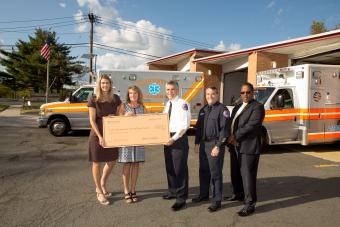 Princeton University representatives present a $500,000 check to Princeton First Aid and Rescue Squad