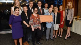 Princeton President Christopher L. Eisgruber presents check to Habitat for Humanity.