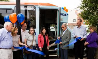 Princeton town officials cut the ribbon to unveil the new freeB community shuttle bus during a ceremony at Hinds Plaza on Thursday, June 16. Princeton University provided funds for the town to purchase the new 21-passenger bus.