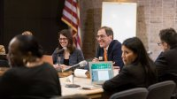 Princeton University President Christopher L. Eisgruber met with Princeton Mayor Liz Lempert (center, left) and members of the town council Monday, Feb. 26, to discuss topics including the University's Campus Plan, town-gown partnerships, the innovation e