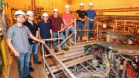 Pre-apprentices pose for a photo by the National Spherical Torus Experiment-Upgrade (NSTX-U) test cell.
