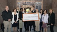 United way representatives and university employees gather for a check presentation