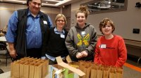 volunteers pack snacks for Anchor House