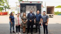 Trenton Health Team and University representatives stand with PPE donation