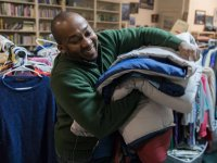 Alvin Daniel, technical support specialist in the Office of the Dean for Research, organizes donated clothes at HomeFront, which helps homeless families build lives of self-respect, stability and independence through a variety of programs.
