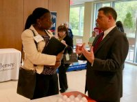 Mohamed Ela, director of procurement services at Princeton, speaks with Lisel White, founder of A Wise Perspective, one of the nearly 100 businesses and organizations represented at the event.