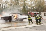 Volunteer firefighters extinguish flames during a training session