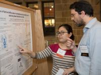 "Senior Angela Kim, who is majoring in molecular biology, discusses her poster, titled ""Roles of RpoS and Efflux Pumps in Strengthening the Permeability Barrier of Stationary Phase Escherichia Coli Cells,"" with judge Yaakov Weinstein."