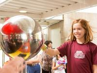 At Community and Staff Day, activities included a Princeton football game, fireworks, a youth sports clinic and an information and activities fair featuring University and community organizations. Above, Charlotte Reedy places a hand on a static electrici